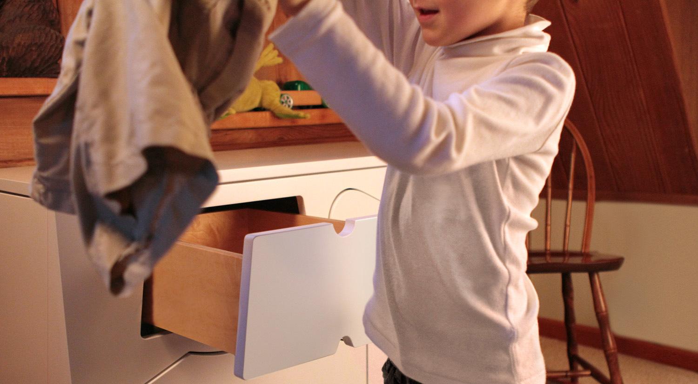A Training Dresser Holding Shorts 2